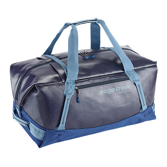 Duffels are simply the best. They are the quintessential adventure bag. Whether you\\\'re hauling camping gear or expedition packing, the Migrate Duffel 90L will haul your gear easily with its heavy duty construction. Carry it on your back, check it at the airport, or tie it down on your vehicle. This duffle will take a beating and then some.